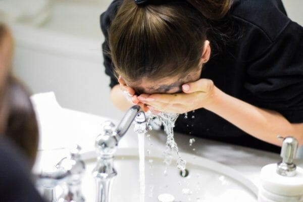 girl washing her face with face wash in pakistan